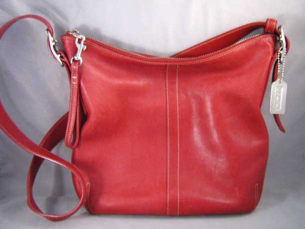 7811ee2ed17f If there is a place to come into contact with a large number of designer  bags, authentic and counterfeit alike, it is among Goodwill's donations!  Coach is ...